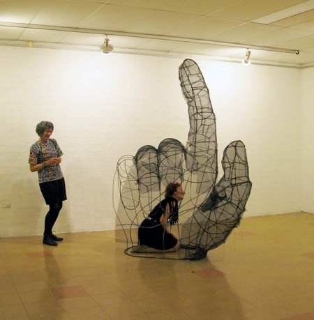 a see-through sculpture of a big hand